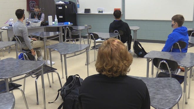 May River High School students attend a socially distanced class during their first week back to in-person instruction during the pandemic.