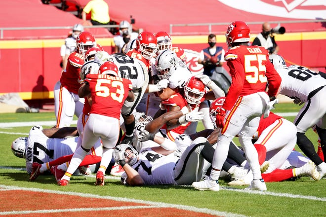 Las Vegas Raiders running back Josh Jacobs (28) goes airborne to score a touchdown during the second half of a game against the Kansas City Chiefs on Sunday afternoon at Arrowhead Stadium in Kansas City.