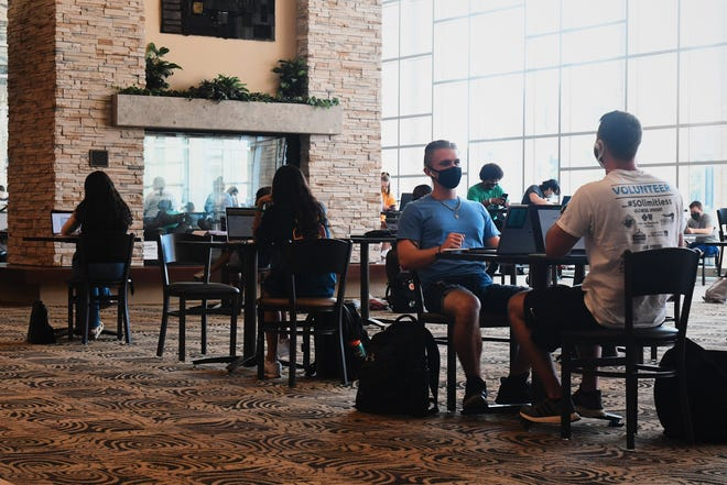 Students study inside of the Student Center on MU's campus on Aug. 24, the first day of classes.