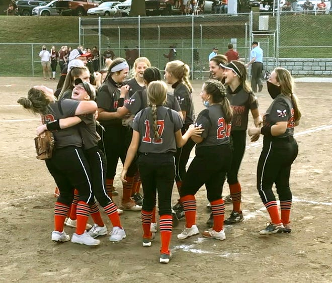 Members of the Chillicothe (Mo.) HS softball Lady Hornets celebrate the final out of their 12-2, 5-innings victory at St. Joseph: Benton Friday, Oct. 9, 2020. The triumph clinched the Midland Empire Conference's undisputed title with a perfect 7-0 record. It's CHS' first MEC softball crown since 2011. ( Photo supplied by CHS coach Lee Rucker )