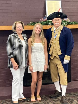 From Left: DAR Regent Doris Spears, C.A.R. President Emily Coxwell, & SAR President Earl F. Mathews, Jr. pose for a picture during the Constitution Week luncheon.