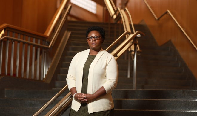 Angela Frost, an attorney at Abercrombie & Fitch, is pictured at the Ohio State University's Moritz College of Law, from which she graduated in 2017. She said she is mindful about her role in inspiring other Black women lawyers.
