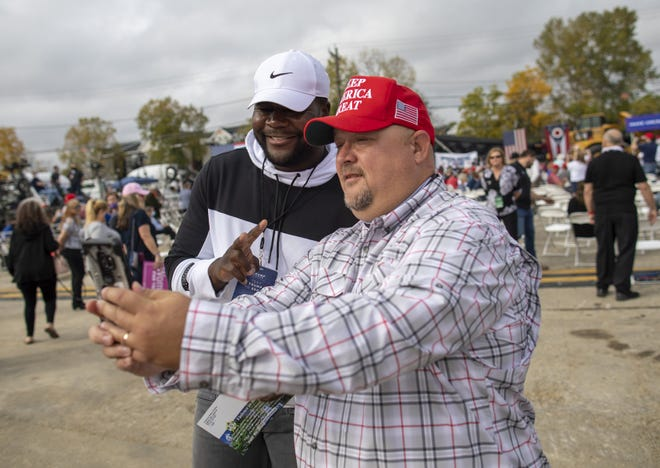 Jeremy Hamm of Piketon takes a photo with former Ohio State quarterback Cardale Jones prior to a campaign stop for Vice President Mike Pence at Nicholas Savko &  Sons in Columbus on Monday, Oct. 12, 2020.