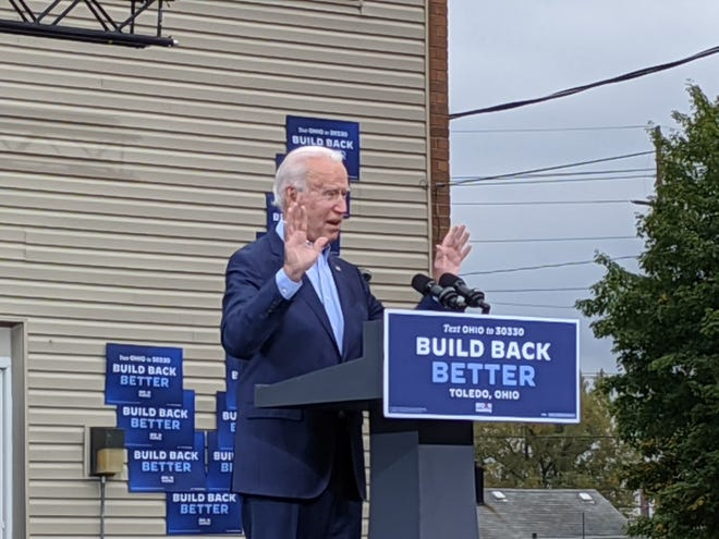 """Joe Biden rallies Ohio voters at a """"drive-in"""" campaign event in the parking lot outside the Toledo United Auto Workers hall."""