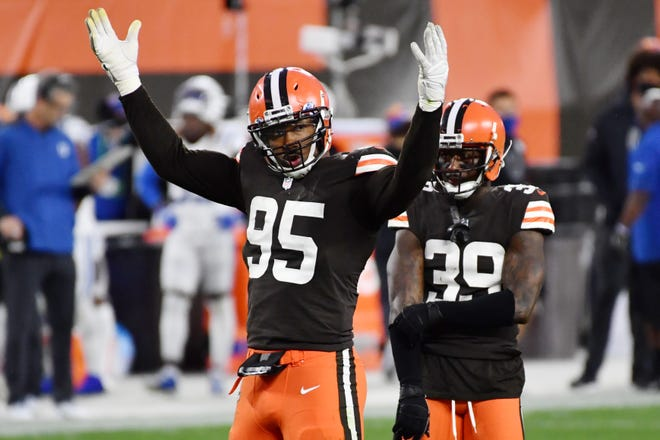 Cleveland Browns defensive end Myles Garrett (95) riles up the crowd during the second half against the Indianapolis Colts at FirstEnergy Stadium on Sunday. The Browns won to improve to 4-1, the franchise's best start in 26 years. [Ken Blaze-USA TODAY Sports]