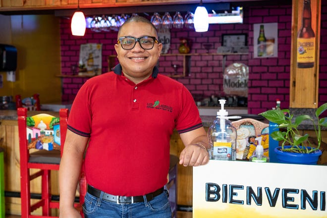 Los Laureles owner Alberto Rojas has a motto: never give up. He and his wife, who just gave birth to their fourth child, opened Los Laureles a year ago fulfilling a life-long dream. [Cindy Peterson/Correspondent]