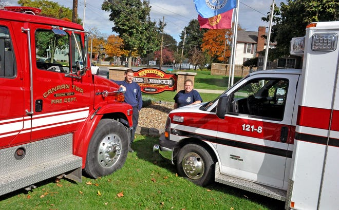 Capt. Andrew Mohn and Deborah Morris of the Canaan Township Fire Department display two of the department's fire and rescue vehicles at Station 1 in Creston. The township is looking to pass a levy for the fire department that was approved by voters last November but revoked by the state tax commissioner due to a mistake in the ballot language.