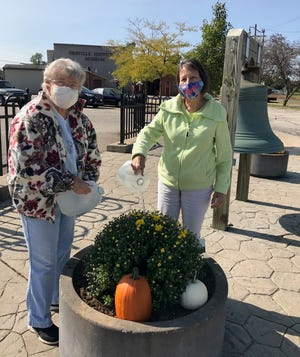 Evergreen Garden Club members Mary Lou Bupp and Linda McHenry kept flower pots watered at the Depot in Orrville during the dry summer months.