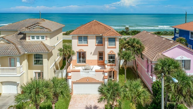 This amazing direct-oceanfront home on Coquina Key Drive in Ormond Beach features wraparound ocean views and three east-and-west balconies/decks to enjoy sunrises and sunsets.