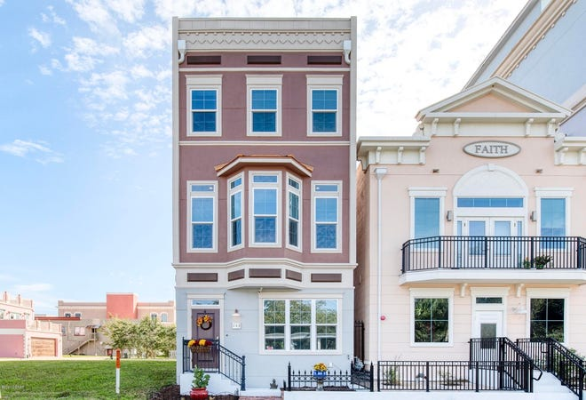 The roof-top terrace of this gorgeous brownstone-style home  overlooks the evolving downtown Daytona Beach skyline.