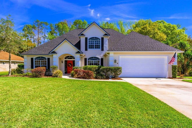 This beautiful pool home in Ormond Beach's highly desired community of Hunters Ridge has been meticulously maintained and has a freshly painted exterior, with mature landscaping, a newer roof and an oversized two-car garage.