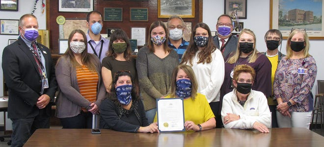 To raise awareness for the one in five American adults diagnosed with a mental illness, the Wayne County Board of Commissioners proclaimed October 4-10 Mental Illness Awareness Week. Seated left to right: JoAnna VanTine, Marie Onukiavage, Marybeth Koniarsky. Standing left to right: Brian Smith, Allison Chory, Dave Hartung, Rebecca Shook, Aleah Shook, James Koniarsky, Carly Shook, Joseph Adams, Gabrielle Gardner, Becky Tyler, and Carol Kneier.