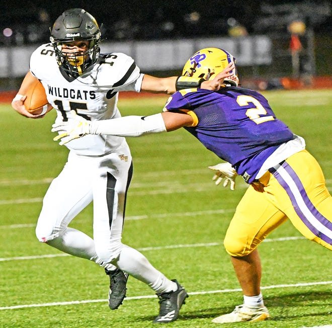 Western Wayne's Caden Brungard (15) stiff-arms a would-be tackler during Week Two Lackawanna Football Conference action against Scranton Prep. Sadly for local fans, the Wildcats, Hornets and Buckhorns all lost on Friday night.