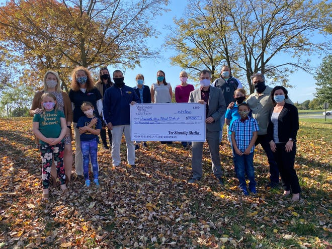VerStandig Media employees and their children who attend Greencastle-Antrim schools presented a check for $10,000 to school district representatives Oct. 7. The money will be used for elementary STEM and literacy.