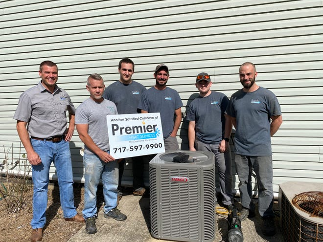 Homeowner Rich Murphy, second from left, is shown with Tim Stenger, owner of Premier HVAC Services, and his Feel The Love installation crew, from left, Keith Heinbaugh, Ryan King, Draven Pensinger and Derek Waltz.