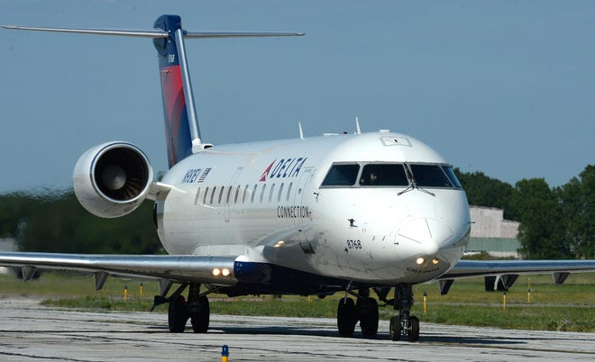 Delta flight 4984 to Detroit taxis on the runway before takeoff June 20, 2020, at the Erie International Airport. Travelers will be able to enroll in TSA PreCheck at the airport next week.