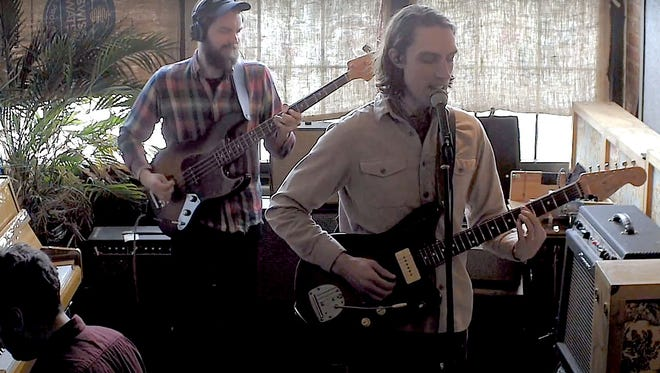 Hollow Engine includes former Erie residents Cory Peterson, 32, right; and Kevin Kniowski, 33, background; and Griffin Novie, 29, of New York City. Not pictured is Cory Peterson's brother, Robin Peterson, 36, also formerly of Erie, on drums. The band is based in Brooklyn, New York.