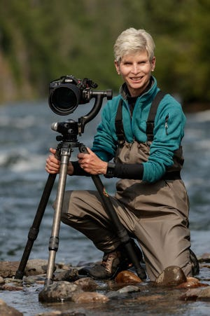 """Patti Larson, president of the Photographic Arts Society of Northwestern Pennsylvania, is shown while taking a photography workshop in Alaska. Works by Larson and other society members will be part of the virtual show titled """"Celebration of Life."""""""