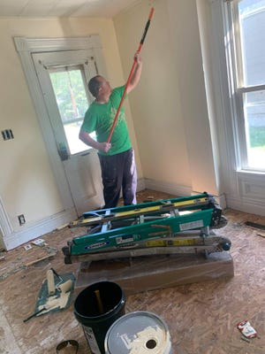 Ryan Parker working on a cleaning and painting job.