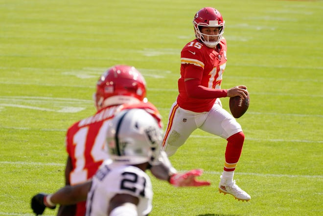 Kansas City Chiefs quarterback Patrick Mahomes scores on a 3-yard touchdown run during the first half of Sunday's game against the Las Vegas Raiders. The Chiefs offense tied it at halftime but sputtered in the second half in a 40-32 loss.