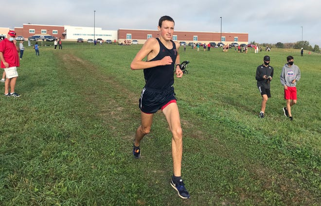 Truman senior Josh Nunn heads to the finish line to claim a dominating individual win and help the Patriots win their first conference cross country title since 1997.