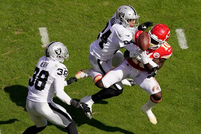 Las Vegas Raiders safety Johnathan Abram (24) and safety Jeff Heath (38) break up a pass intended for Kansas City Chiefs wide receiver Tyreek Hill (10) during the first half of Sunday's game at Arrowhead Stadium. The Raiders had not won at Arrowhead since 2012 but changed that with a 40-32 win.