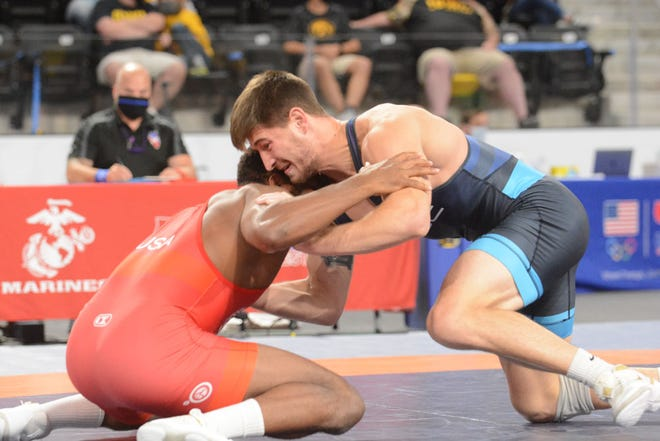 Drew Foster (right), a graduate of Mediapolis High School, wrestles Nate Jackson in the U.S. Senior Nationals on Saturday at Coralville.