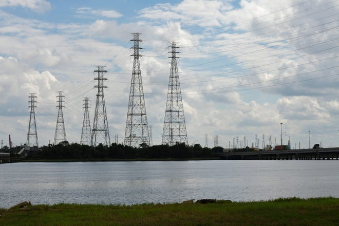 JEA power lines from the St. Johns River Power Park stretch over the St. Johns River and Blount Island Monday, October 12, 2020 in Jacksonville, Florida. (Will Dickey/Florida Times-Union)