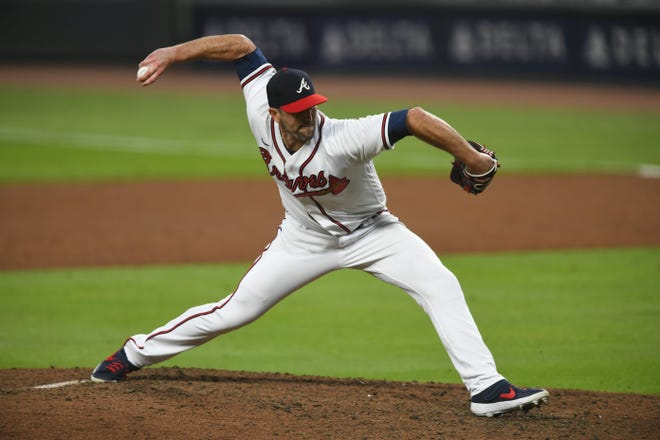 "After 13 Major League Baseball seasons, Atlanta Braves pitcher and BIshop Kenny High product Darren O'Day is grateful for his ""charmed"" career. The Braves take on the Los Angeles Dodgers in the National League Championship Series. (AP Photo/John Amis)"