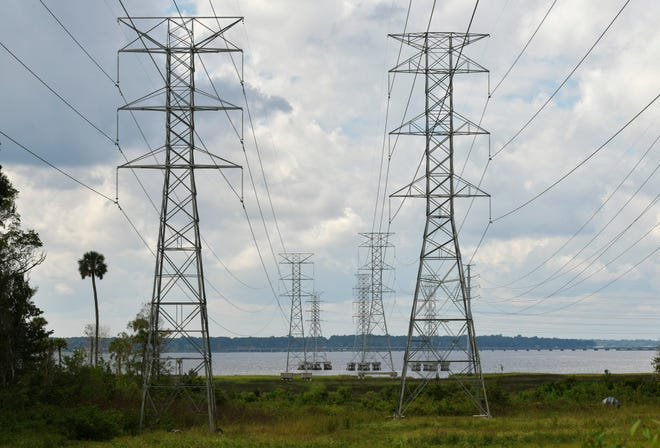 JEA power lines from Arlington stretch over the St. Johns River and Blount Island to the St. Johns River Power Park Monday, October 12, 2020 in Jacksonville, Florida.
