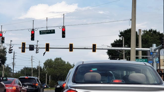 A new steel pole-suspended set of traffic signals with illuminated street signs is close to being activated behind the old cable-hung units on San Jose Boulevard and mandarin Road.