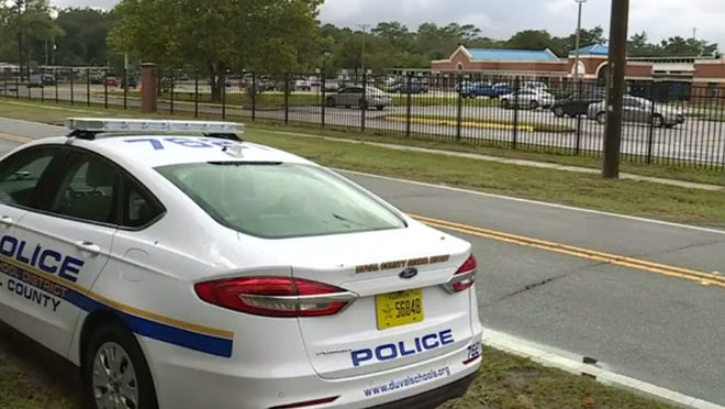 A Duval County School Police car is shown outside Ribault High School.