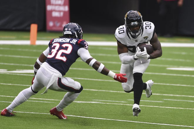 Jaguars running back James Robinson (30) puts a move on Houston Texans cornerback Lonnie Johnson (32) in Sunday's 30-14 loss at NRG Stadium. The coaching staff didn't use Robinson enough against the NFL's worst run defense and it proved costly.