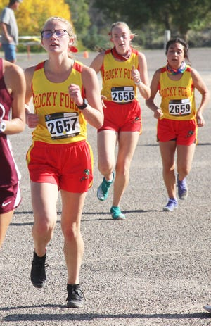Rocky Ford High School's Kaysa Kurtz-Merwin, Kailene Black and Anahy Prieto on the cross country trail at the Class 2A Region 3 Meet Friday in Rocky Ford.