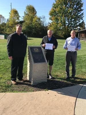 Hudson Kiwanis President, Barak Kraus welcomes new members Mike Bonsiewicz and Kevin Bauer at the Hudson splash pad, one of the many local projects Hudson Kiwanis has been proud to support.