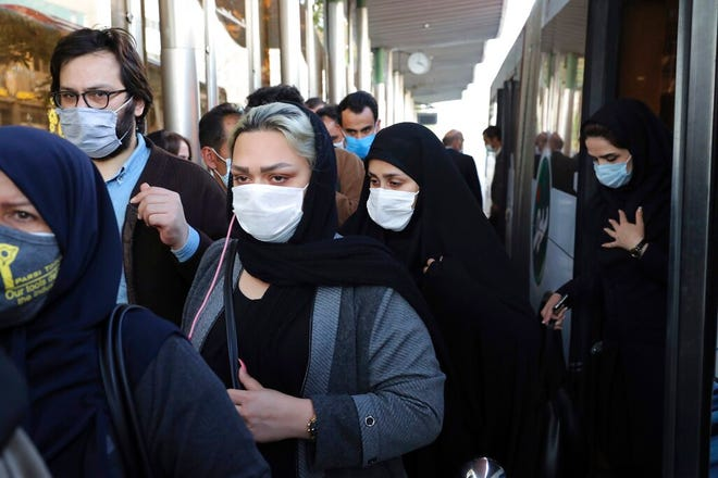 FILE - In this Sunday, Oct. 11, 2020 file photo, people wear protective face masks to help prevent the spread of the coronavirus in downtown Tehran, Iran. For the second day in a row, Iran announced Monday its highest single-day death toll from the coronavirus with 272 people killed. The announcement by Health Ministry spokeswoman Sima Sadat Lari saw Iran also give its single-day highest count of new cases with 4,206 new patients.