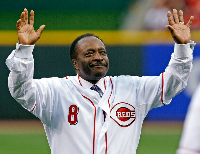 In this April 7, 2010, file photo, Cincinnati Reds Hall of Fame second baseman Joe Morgan acknowledges the crowd after throwing out a ceremonial first pitch prior to the Reds' baseball game against the St. Louis Cardinals, in Cincinnati. Hall of Fame second baseman Joe Morgan has died. A family spokesman says he died at his home Sunday, Oct. 11, 2020, in Danville, California.