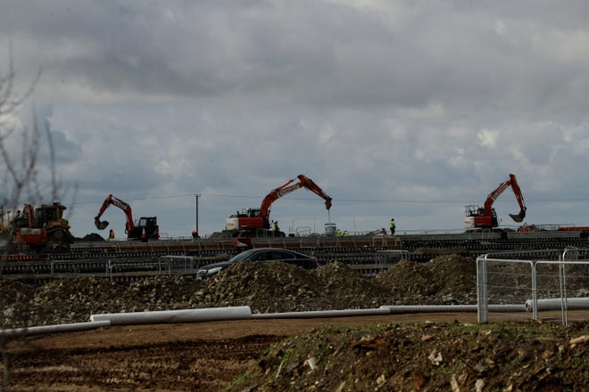 Construction takes place on a post-Brexit customs clearance border post facility on land that was previously a field between the villages of Mersham and Sevington in the county of Kent, south east England, last week. In the corner of Britain known as the Garden of England, Brexit is literally taking concrete form. Diggers, dump trucks and cement mixers are transforming a field in the village of Sevington into a customs clearance depot with room for up to 2,000 trucks. It's part of Britain's new border with the European Union, and no one asked the locals for their permission.