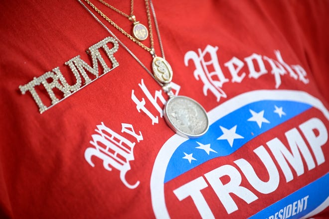 Henrietta Amey, 83, shows her support for President Donald Trump before a campaign rally appearance by Vice President Mike Pence on Saturday at The Villages.