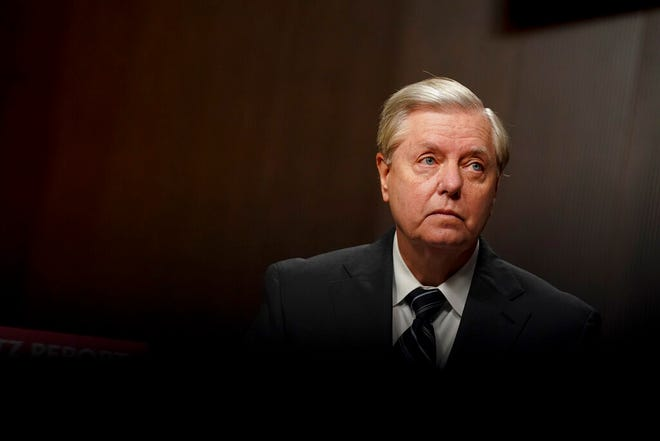 "FILE - In this Wednesday, Sept. 30, 2020, file photo, Sen. Lindsey Graham, R-S.C., appears before a Senate Judiciary Committee hearing on Capitol Hill in Washington,  to examine the FBI ""Crossfire Hurricane"" investigation. Once a biting critic of President Donald Trump, the Senate Judiciary Committee chairman on Monday opens confirmation hearings for Judge Amy Coney Barrett in a bid to seal a 6-to-3 conservative majority on the Supreme Court."
