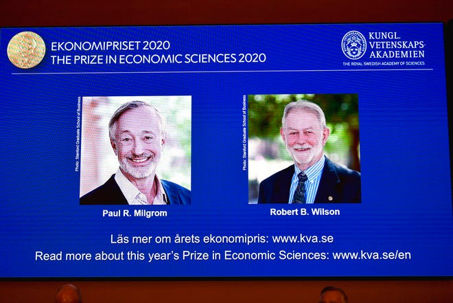 "Winners of the Sveriges Riksbank Prize in Economic Sciences in Memory of Alfred Nobel for 2020 at a press conference in Stockholm, Monday Oct. 12, 2020. Americans Paul R. Milgrom, left, and Robert B. Wilson have won the Nobel Prize in economics for ""improvements to auction theory and inventions of new auction formats."""