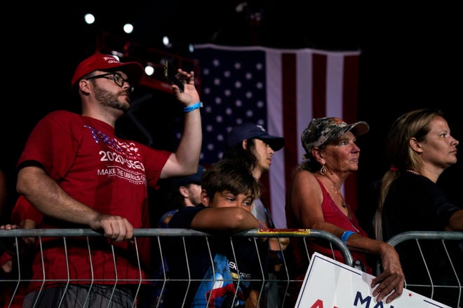Maskless supporters attend a Trump rally Oct. 12 in Sanford.