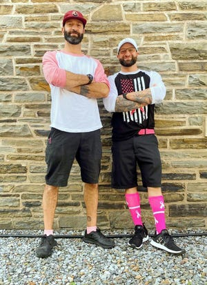 To help fight breast cancer, Colin, left, and brother Tucker Ray of Ray Brothers Barbecue in Bouckville are battling it out in their favorite pink apparel to see 'who wore it better' each week in October. Find Ray Brothers Barbecue on Facebook for full details.