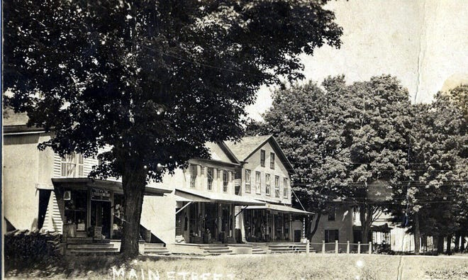 This early photo of Eaton's Main Street shows the Morse Store to the right.