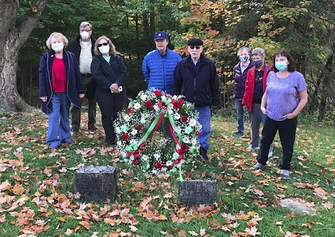 A wreath laying ceremony on Oct. 8 honored John B. Marchisi's burial plot at Forest Hill Cemetery. He was the first Italian Immigrant ot Utica. Italian Heritage Club of the Mohawk Valley members left to right: Joann Campbell (president), Phil Bean, Lori Johnson, Anthony Palumbo,  Joseph Bottini, Marilyn Valvo, Rose Hosp, Joann Haley. [Submitted photo]