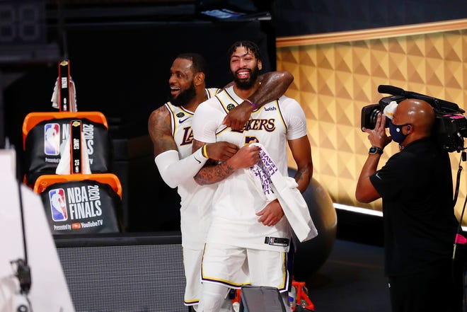 Los Angeles Lakers LeBron James (23) and Anthony Davis (3) celebrate during the fourth quarter in Game 6 of the 2020 NBA Finals at AdventHealth Arena. The Los Angeles Lakers won 106-93 to win the series. [Kim Klement-USA TODAY SportsMandatory Credit: Kim Klement-USA TODAY Sports]