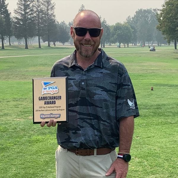 Swenson Park Golf Course General Manager Joe Smith poses with his plaque from winning the PGA Jr. League Game Changer Award.