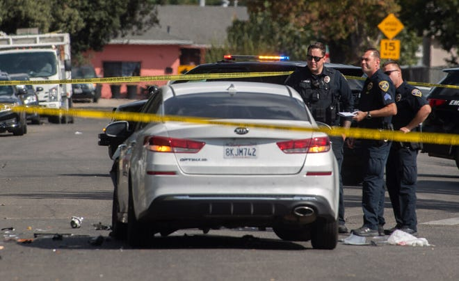 Stockton police officers investigate a shooting scene Saturday on East Marsh Street that resulted in the death of a 19-year-old man and the wounding of a 17-year-old boy.