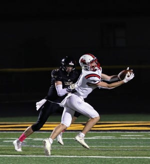 Carter Flattebo attempts to haul in a reception during Roland-Story's 56-40 loss at Clear Lake Friday. Flattebo had eight catches for 95 yards for the Norsemen.