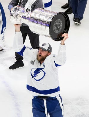 Tampa Bay Lightning's Steven Stamkos (91) hoists the Stanley Cup after defeating the Dallas Stars in the Stanley Cup finals, in Edmonton, Alberta, on Sept. 28, 2020.